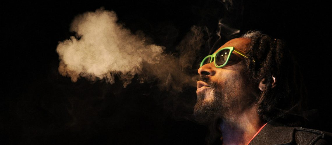 Snoop Dogg blowing smoke